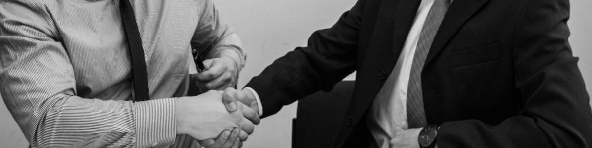 Men Shaking Hands At Job Interview